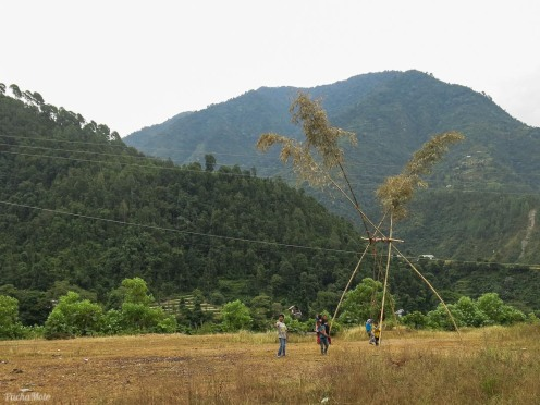 Kids playing on a swing on route to Kathamndu